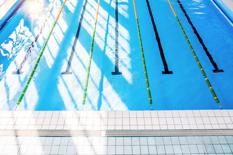 Lanes of an indoor public swimming pool. royalty free stock photography