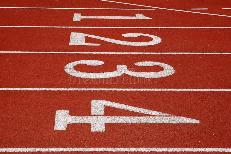 Lanes one through four on a running track royalty free stock image