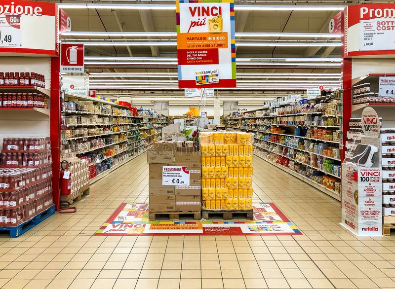 Lanes of shelves with goods products inside of the IPER of Varese hypermarket. Breakfast department with bread and flour counter i stock photography