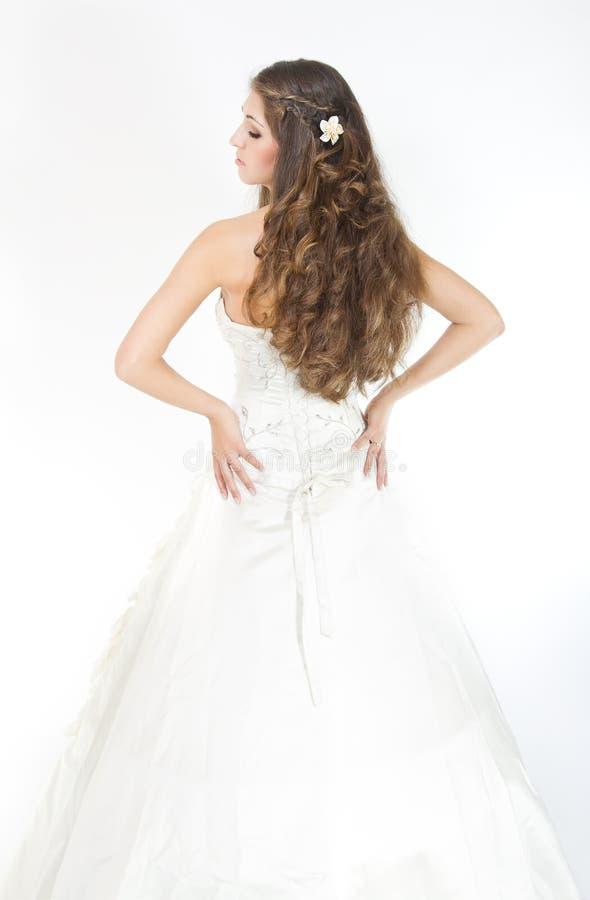 Lang krullend haar. Het kapsel van de bruid. Achter mening royalty-vrije stock afbeelding