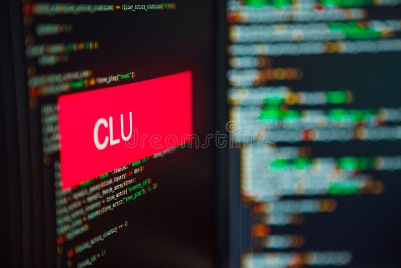 Langage de programmation, inscription de CLU sur le fond du code informatique photos libres de droits