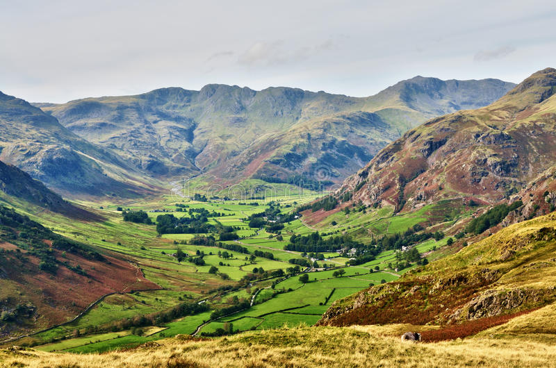 Langdale, with Bowfell and Crinkle Crags. A sweeping view of Langdale, a glaciated valley, set against a backdrop of Bowfell and Crinkle Crags, on a summers day royalty free stock photography