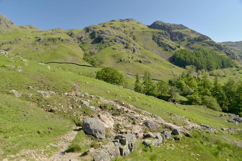 Langdale Pikes at head of Mickleden valley, Lake District. Langdale Pikes above the head of Mickleden valley in the English Lake District royalty free stock image