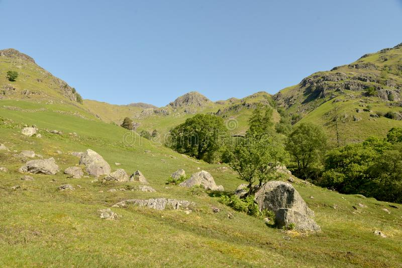 Langdale Pikes at head of Mickleden valley, Lake District. Langdale Pikes above the head of Mickleden valley in the English Lake District stock photo