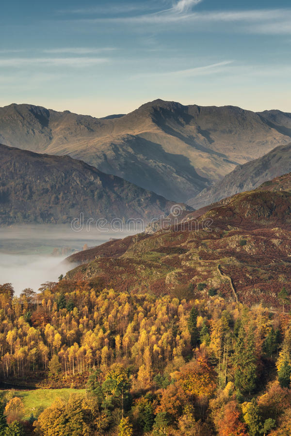 Langdale Pikes In Autumn. A view of the stunning Langdale Valley covered in lingering fog. The valley is a popular tourist area of the English Lake District The royalty free stock images