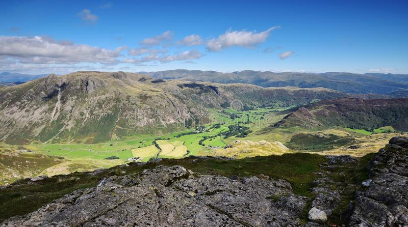 The Langdale Pikes. The green pasture of the Langdale valley stock images