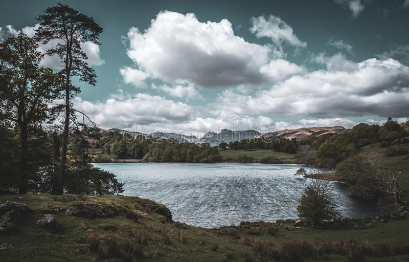 The Langdale Pikes and Loughrigg Tarn. English Lake District stock images