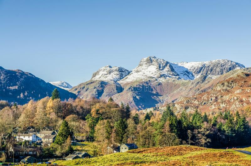 Langdale Pikes over Elterwater village, English Lake District, UK. The Langdale Pikes over the village of Elterwater, Langdale, English Lake District, UK on royalty free stock photography