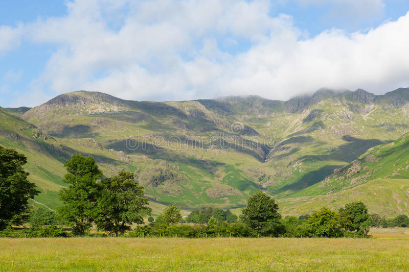 Langdale Valley Lake District Cumbria near Old Dungeon Ghyll England UK in summer blue sky. And clouds scenic royalty free stock images