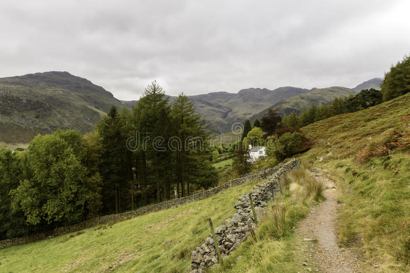 The Langdale Valley in The Lake District. A path in The Langdale Valley near The Old Dungeon Ghyll Hotel stock photos