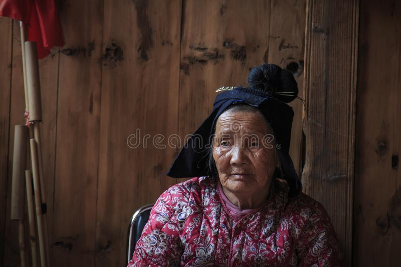 Old Miao woman in Langde Miao village, Guizhou province, China. Langde, China - March 27, 2018: Old Miao woman in Langde Miao village, Guizhou province, China royalty free stock images