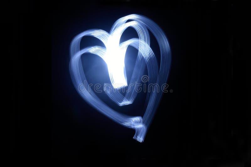 Lange Belichtung eines Herzanschlags stockbild