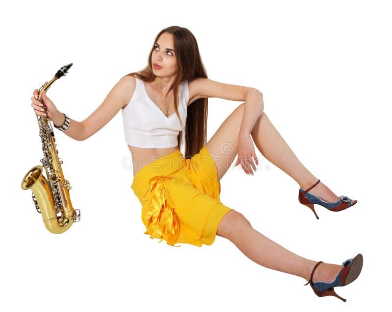 Langes Sitzen der Frauen mit Saxophon stockbilder