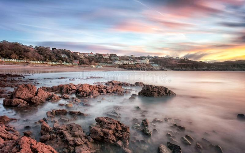 Langland Bay sunrise. Small wooden chalets and a sunrise at Langland Bay on the Gower coast Swansea, UK stock images
