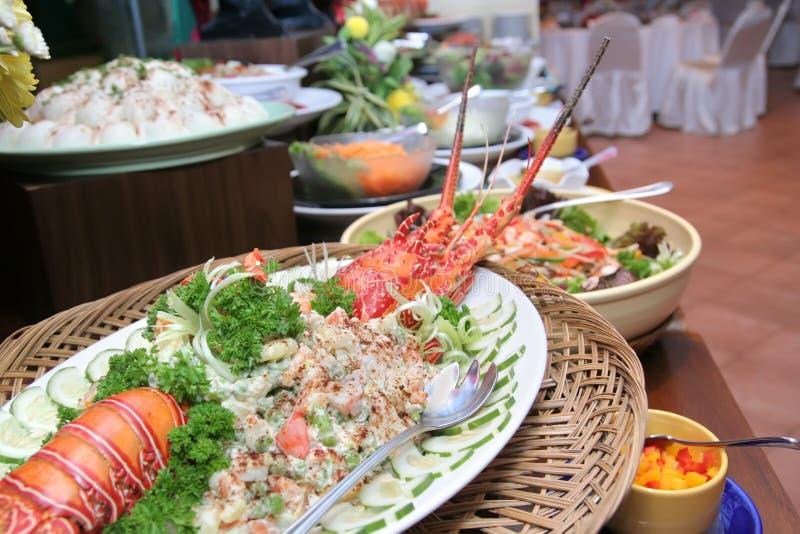 Langosta en cena de la comida fría fotografía de archivo libre de regalías
