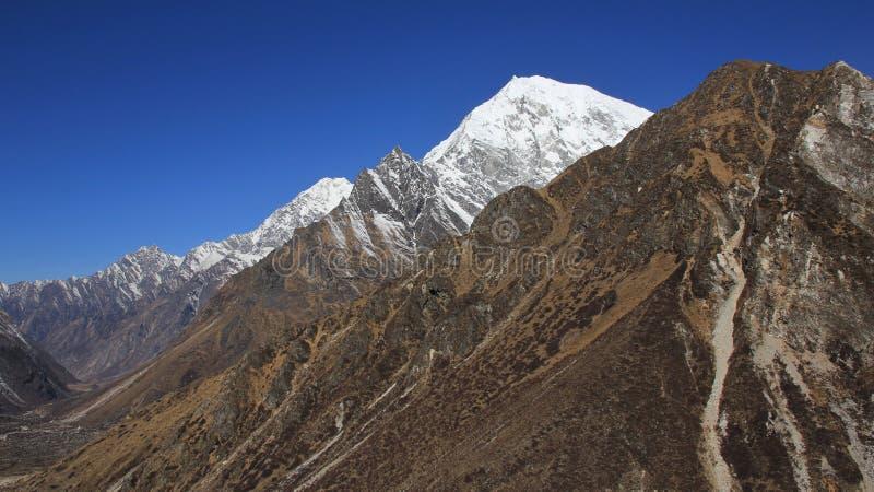 Langtang Lirung, montanha alta da escala de Langtang Himal Kyan fotos de stock