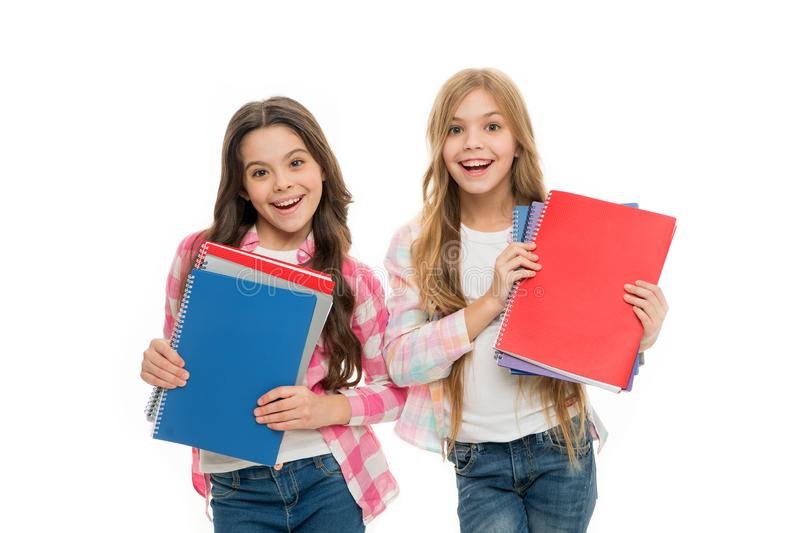 Language courses for youth. Girls with school textbooks white background. School concept. We love study. Pupils carrying royalty free stock photos