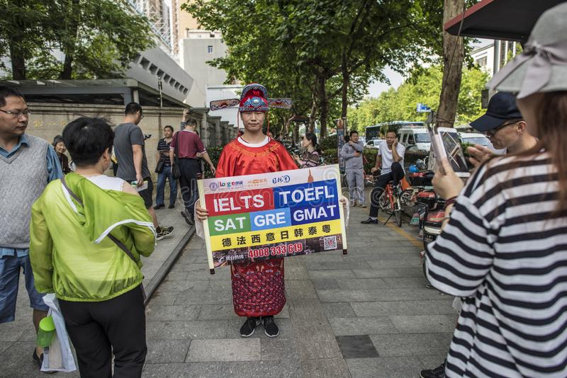 A language education institution staff wears a champion costume and recommends foreign language courses to parents of students out stock photos
