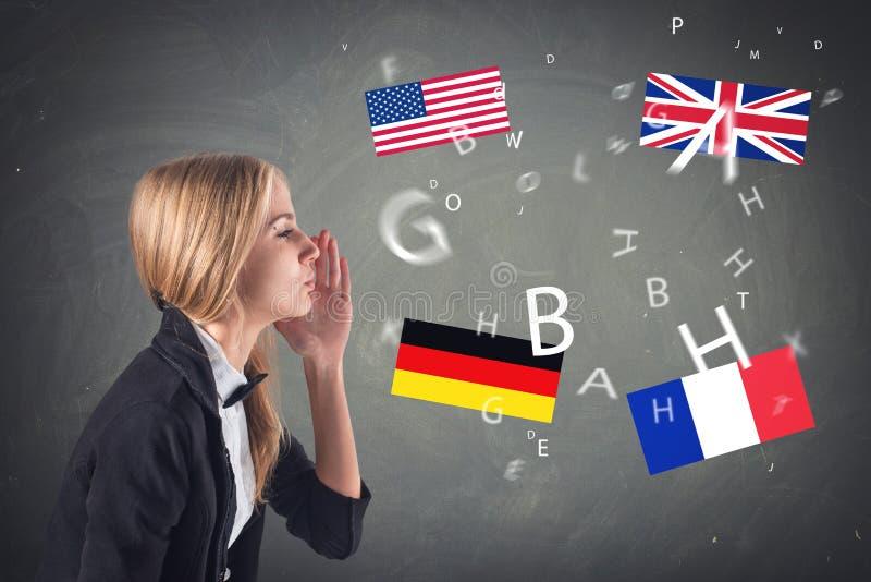Langue étrangère. Concept - apprenant, parlant, photo stock