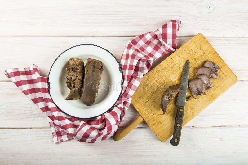 Langue bouillie de porc photos stock