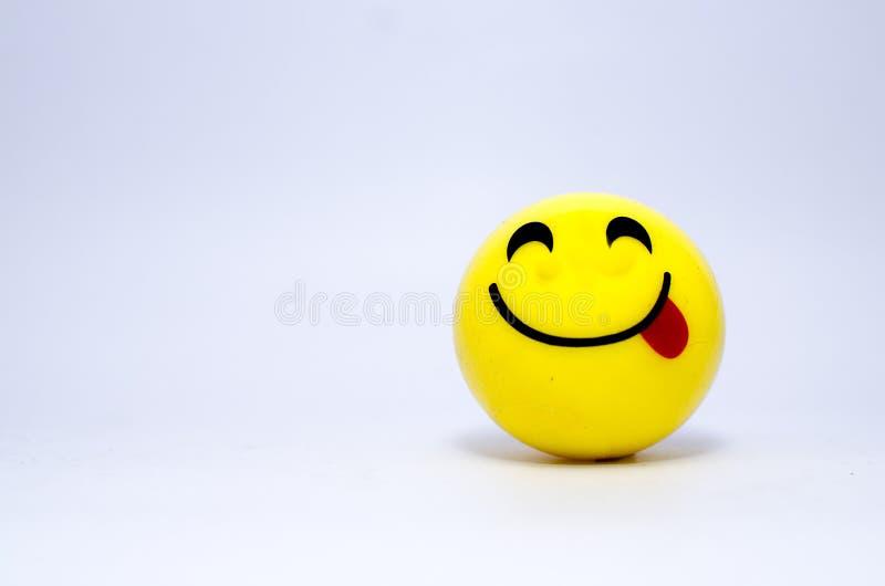Langue de représentation souriante jaune images libres de droits