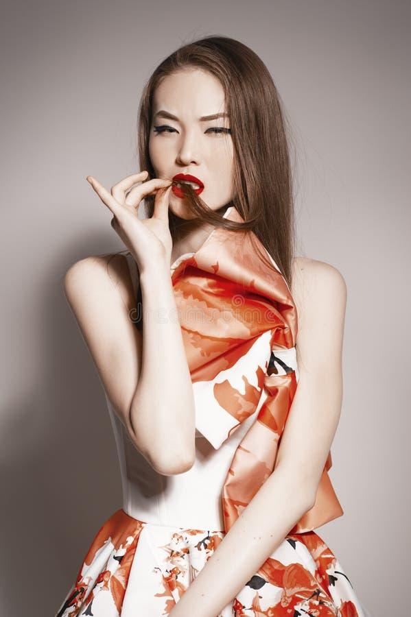 Languishing look young beautiful asian brunette royalty free stock photos