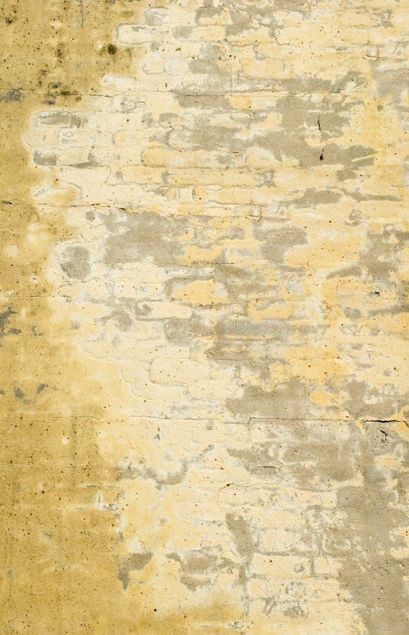 Langzaam verdwenen Gele Bakstenen muur royalty-vrije stock foto's