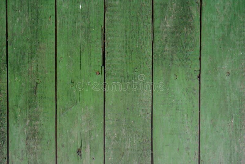 Langzaam verdwenen groene houten oude planking achtergrond met barsten royalty-vrije stock fotografie