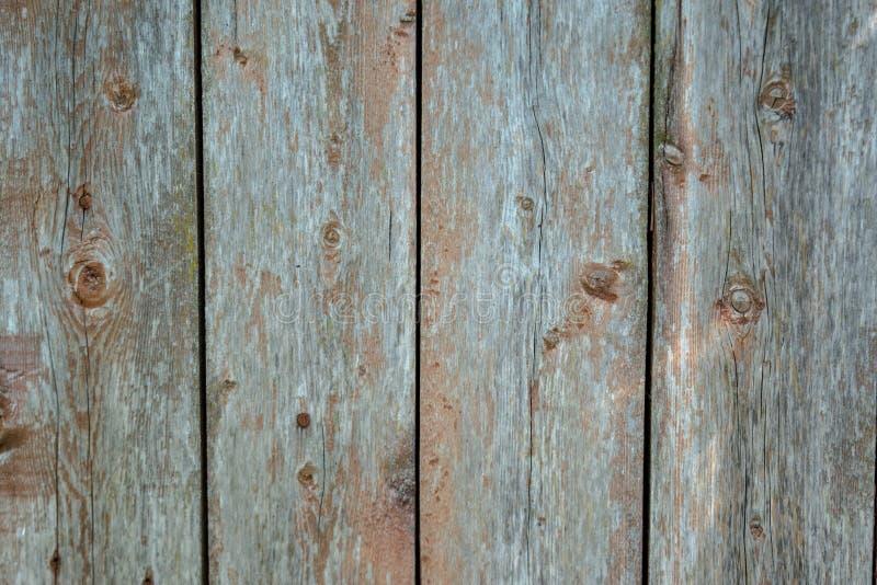 Langzaam verdwenen rode oude houten planking achtergrond met flawes royalty-vrije stock afbeelding