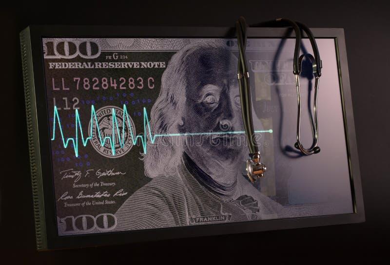 Langzaam verdwijnende cardiogram en stethoscoop tegen de achtergrond van stock foto