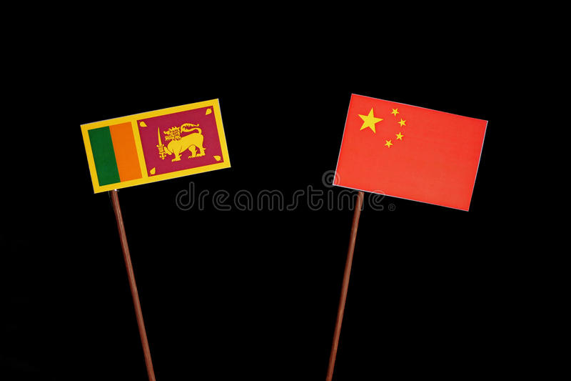 Lankijczyk flaga z chińczyk flaga na czerni zdjęcie royalty free
