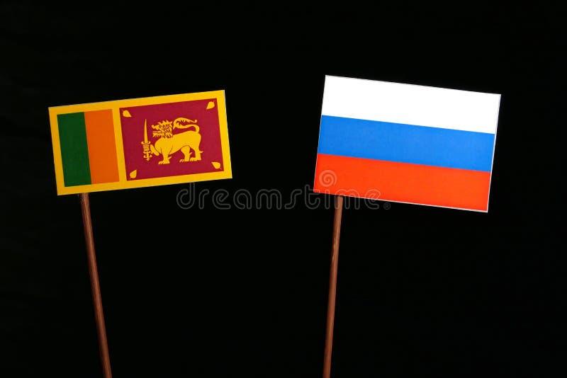 Lankijczyk flaga z rosjanin flaga na czerni zdjęcia stock