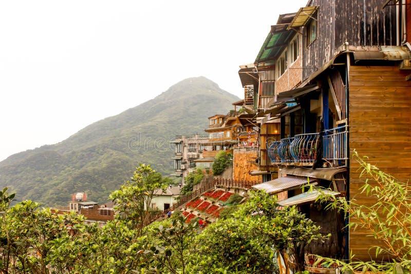 Lanscape Jiufen restaurangbyggnader på berget royaltyfri bild