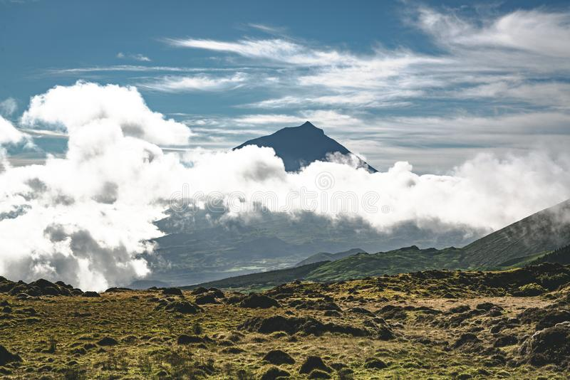 Lanscape near EN3 longitudinal road northeast of Mount Pico and the silhouette of the Mount Pico along , Pico island. Azores, Portugal. Photo taken in Azores stock images