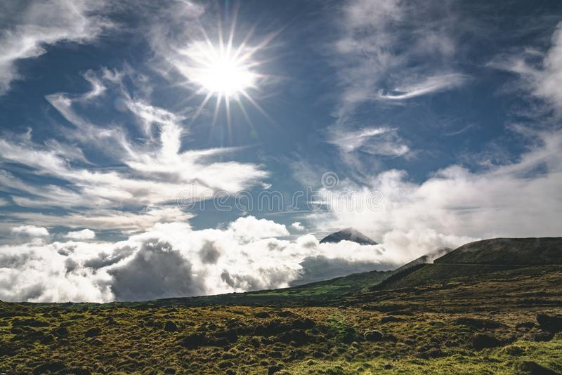 Lanscape near EN3 longitudinal road northeast of Mount Pico and the silhouette of the Mount Pico along , Pico island. Azores, Portugal. Photo taken in Azores royalty free stock photos