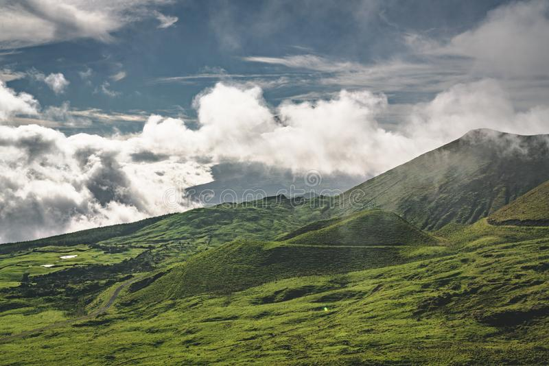 Lanscape near EN3 longitudinal road northeast of Mount Pico and the silhouette of the Mount Pico along , Pico island. Azores, Portugal. Photo taken in Azores stock image