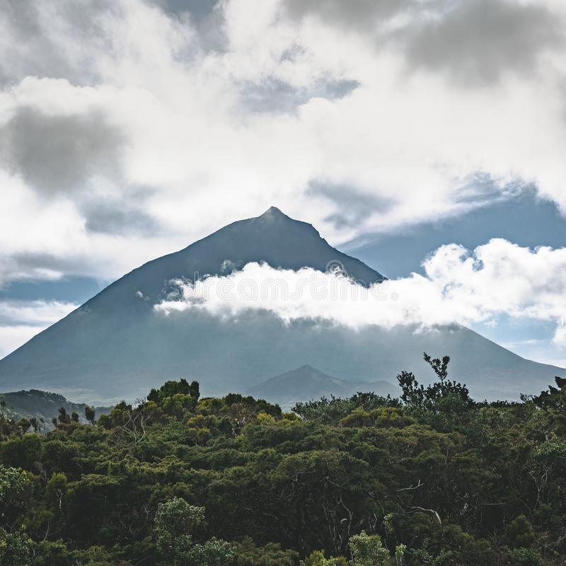 Lanscape near EN3 longitudinal road northeast of Mount Pico and the silhouette of the Mount Pico along , Pico island. Azores, Portugal. Photo taken in Azores stock photo