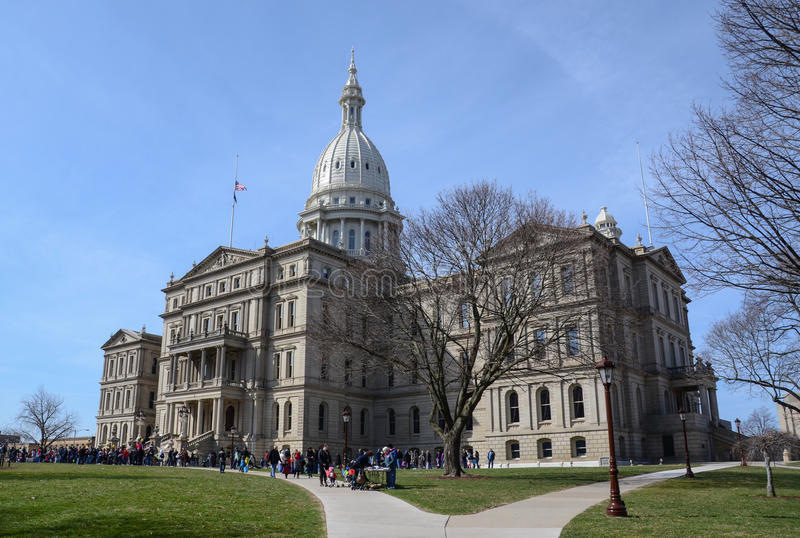 Lansing capitol side view. LANSING, MI - MARCH 27: The Michigan State Capitol, hosted a visit by the Easter Bunny on March 27, 2016 royalty free stock photos