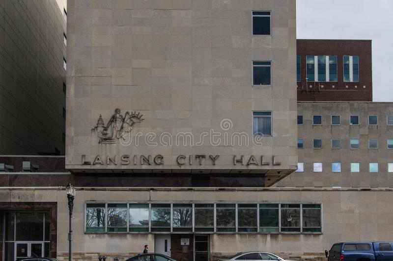 Lansing Michigan City Hall Exterior. Lansing, Michigan, USA - March 14, 2019: Exterior front entrance of the Lansing City Hall in the downtown district royalty free stock photo