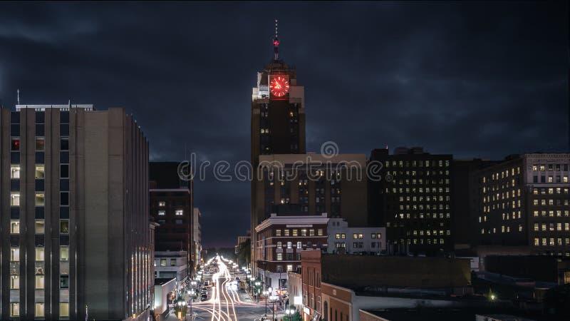 Lansing Michigan Cityscape at Night with Traffic. A long exposure traffic shot of Lansing Michigan with the Boji Tower stock image