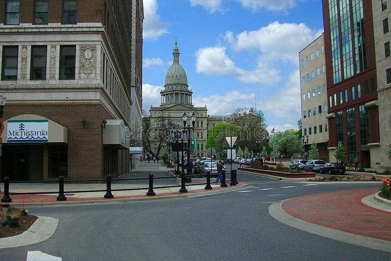 Lansing, Michigan with State Capitol Building. Architecture and street scene in downtown Lansing, Michigan with the Capitol building as background stock photography