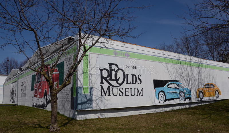 Lansing Olds museum front. LANSING, MI - MARCH 27: Lansing's Olds Transportation Museum, whose back mural is shown on March 27, 2016, is one of the top royalty free stock images