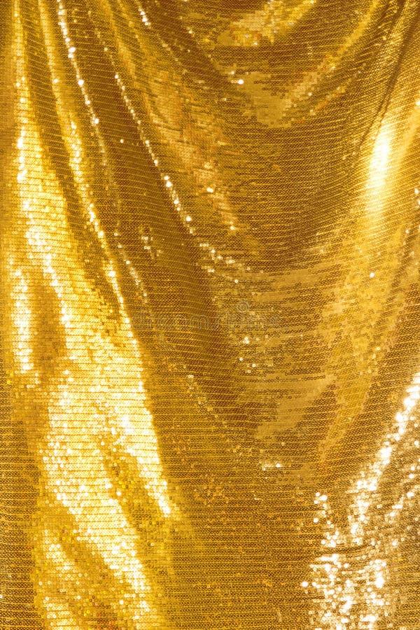 Lantejoulas douradas - matéria têxtil sequined efervescente foto de stock