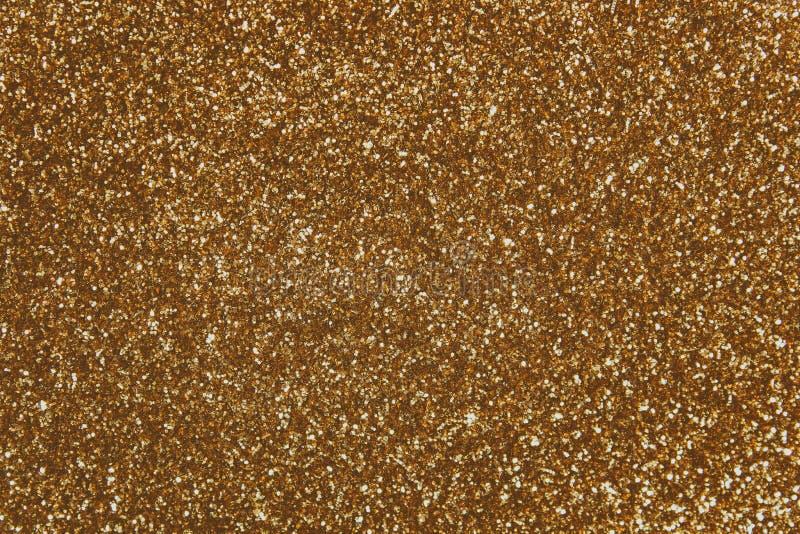 Lantejoulas douradas - matéria têxtil sequined efervescente imagem de stock
