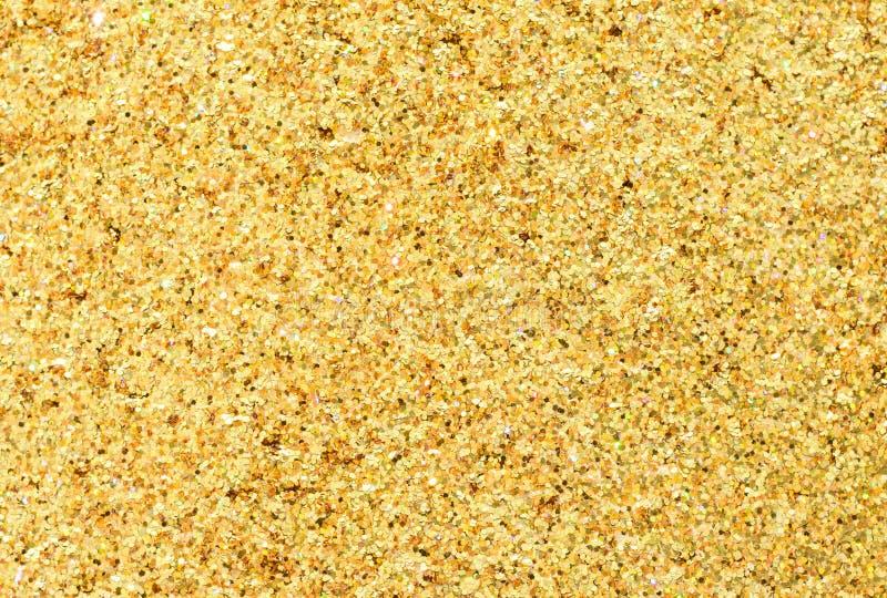 Lantejoulas metálicas do ouro fotos de stock