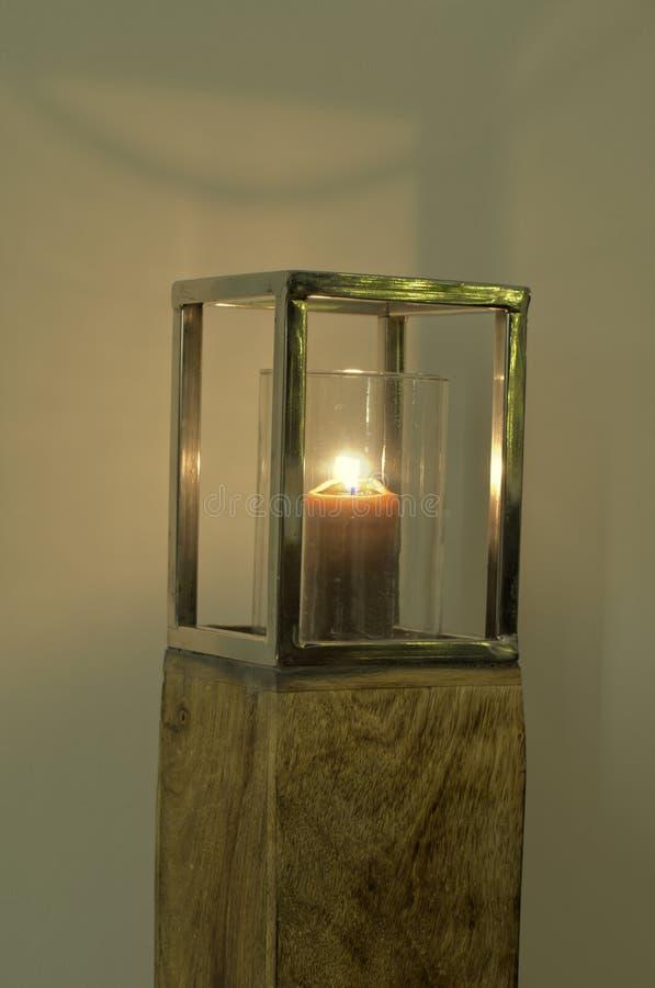 Lantern on block of wood stock image