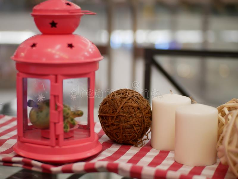 lantern candle and alarm clock with red and white fabric artificial flowers bouquet home decoration concept on bokeh background stock photo