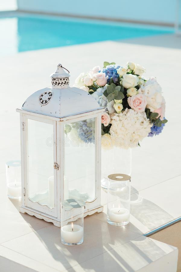 Lantern, candles and bouquet on wedding ceremony on Santorini island stock images