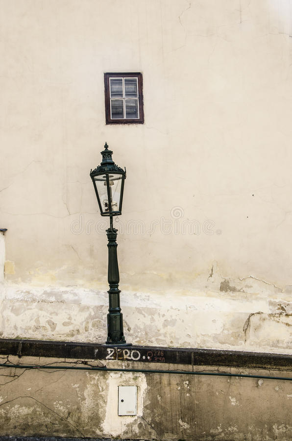 Lantern on cracked wall royalty free stock photo