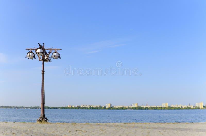 Lantern on the empty quay. Dnepr River royalty free stock photo